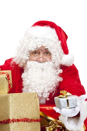 nikolaus: Closeup of old happy Santa Claus holding a Christmas present in his hands. Isolated on white.