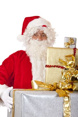 nikolaus: Santa Claus is holding several Christmas gifts in his hands. Isolated on white.