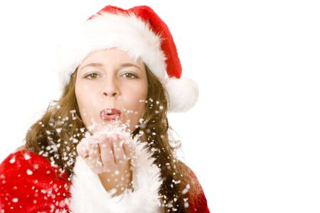 Closeup of Santa Claus woman which is blowing Christmas snow from her palms. Isolated on white.