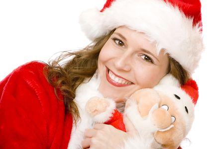 pere noel sexy: Jeune femme attrayante du p�re No�l souriante tenant une poup�e de Santa armes