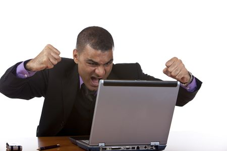 Closeup of stressed businessman which is angry in his office, because his computer has a crash. Isolated on white. photo