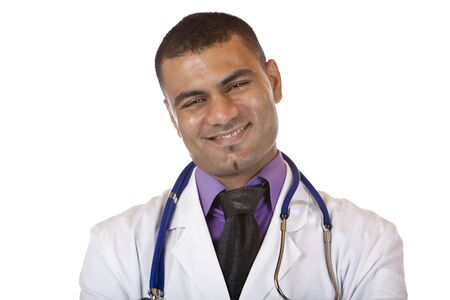 Medical doctor with crossed arms, standing self confident and looks into camera. Isolated on white. photo