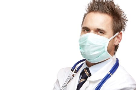 malady: Standing medical doctor with mask and stethoscope looks self confident into camera. Isolated on white. Stock Photo