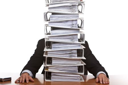 Businessman is frustrated, because of the huge documents he has to do. Isolated on white. Stock Photo