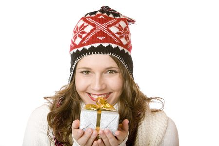 Young happy woman with cap is holding Christmas gift in hands. Isolated on white. Stock Photo - 6440148