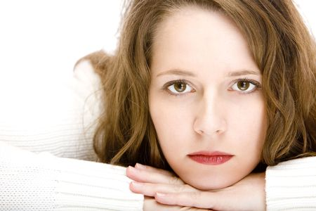 heartsickness: Young beautiful woman lying on floor and looks sad into camera.