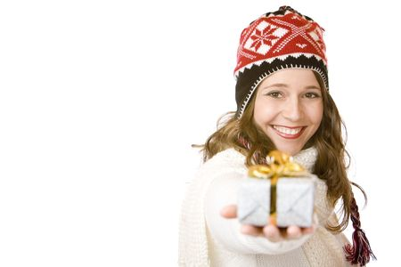 Young happy woman with cap is holding Christmas gift in hand. Isolated on white.