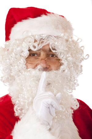 hist: Closeup of Santa Claus holding his finger on lips to have silence.  Isolated on white.