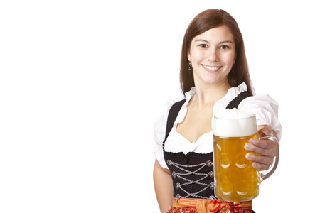Happy Bavarian woman holding Oktoberfest beer stein (Mass) in camera. Isolated on white background.