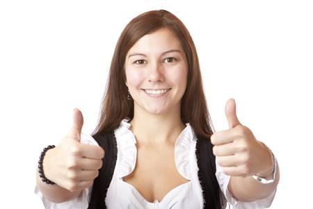 Portrait of Bavarian Woman with dirndl showing thumbs up. Isolated on white background. photo