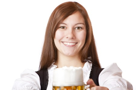Happy smiling Bavarian woman in dirndl holding Oktoberfest beer stein. Isolated on white background. photo
