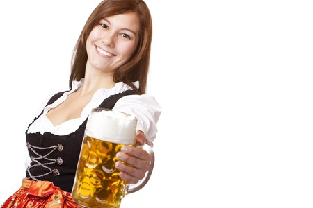dirndl dress: Happy smiling woman in dirndl dress holding Oktoberfest beer stein. Isolated on white background.