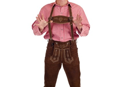 Bavarian man with oktoberfest leather trousers stands casual. Isolated on white background. photo