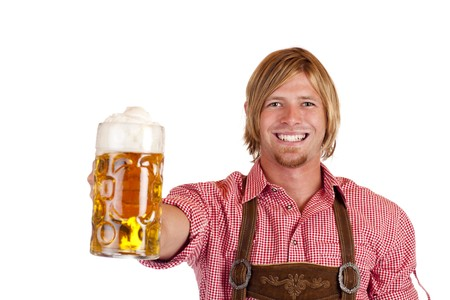 Happy smiling man with leather trousers (lederhose) holds oktoberfest beer stein. Isolated on white background. photo