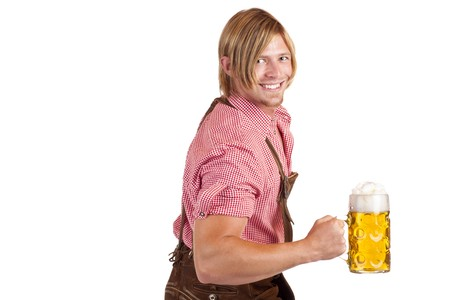 stein: Bavarian man shows biceps muscles and holds oktoberfest beer stein.  Isolated on white background. Stock Photo