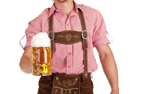 stein: Bavarian man with leather trousers (Lederhose) holds Oktoberfest beer stein. Isolated on white background.