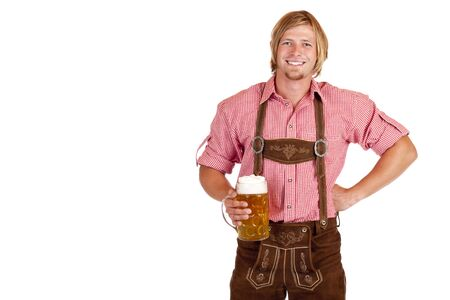 Bavarian man with leather trousers (lederhose) holds oktoberfest beer stein in hand. Isolated on white background. photo