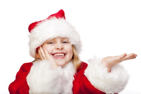 Small girl dressed as santa claus holdes palm for ad copy-space. Isolated on white background. photo