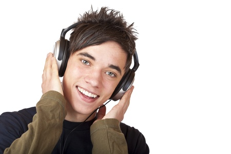 Male Teenager listening to music via headphone and sings. Isolated on white background. Stock Photo - 8422968