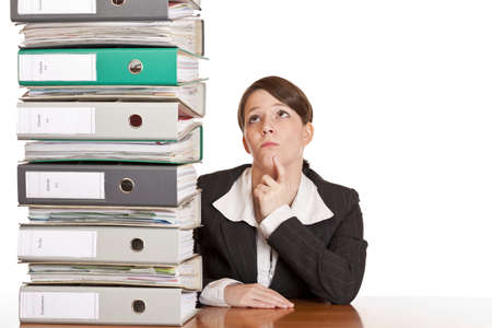 business woman thinks about solving problem with folder stack. Isolated on white background. photo