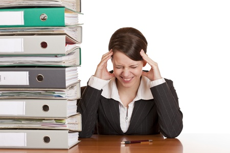 Business woman in office has migraine because of stress. Isolated on white background. photo