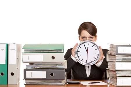 Woman in office is stressed because of time pressure. Isolated on white background. photo