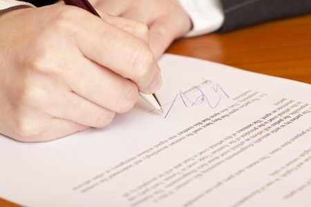 people holding sign: Close-up macro of signing a contract. Stock Photo