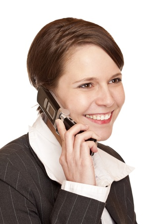 Young attractive business woman talks to client on the telephone. Isolated on white background. photo