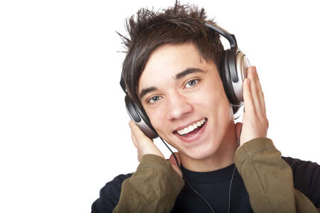 Male Teenager listening to music via headphone and sings. Isolated on white background. Stock Photo - 8588946