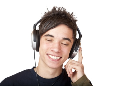 Male Teenager listening to music and smiles happy. Isolated on white background. photo