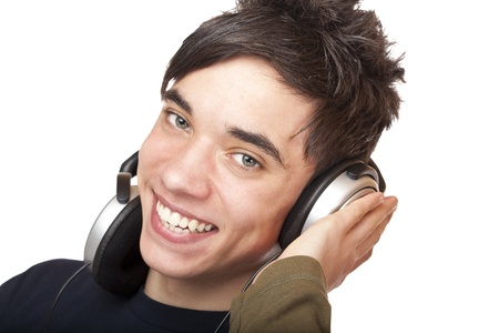 Teenager with headphones listens to music and smiles happy. Isolated on white background. Stock Photo - 8589041