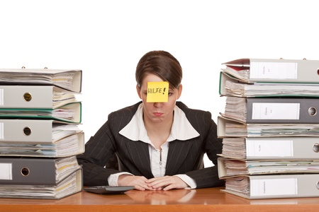 Business woman in office between folder stacks needs help. Isolated on white background. photo