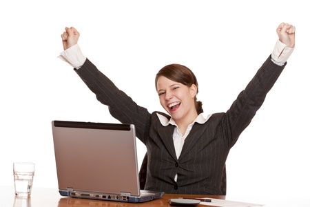hurray: Young woman  in office jubilates at desk. Isolated on white background.