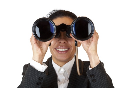 Woman looks through binoculars and found business. Isolated on white background. photo