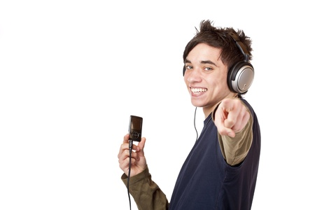Teenager with headphones and mp3 player points with finger. Isolated on white background. photo