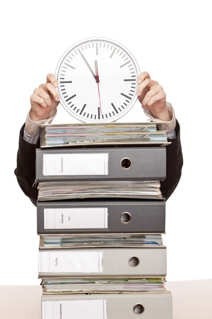 test deadline: Business woman in office with folder stacks is under time pressure. Stock Photo