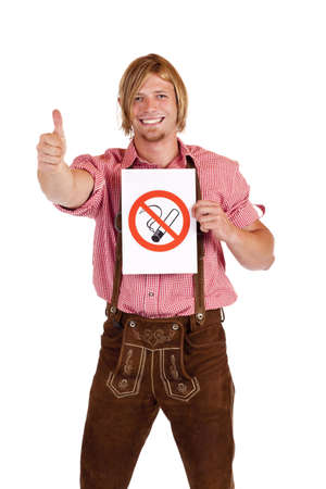 agrees: Smiling Bavarian man in lederhose agrees to non-smoking-rule. Isolated on white background.