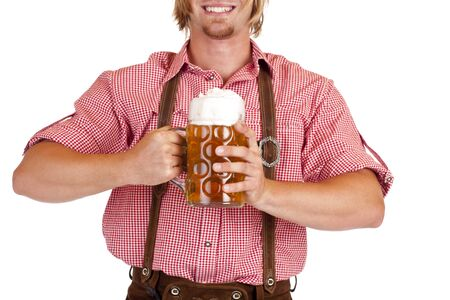 Bavarian man with leather trousers (Lederhose) holds Oktoberfest beer stein. Isolated on white background. photo