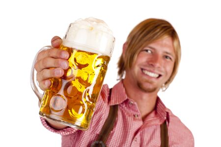 stein: Happy smiling man with leather trousers (lederhose) holds oktoberfest beer stein. Isolated on white background.