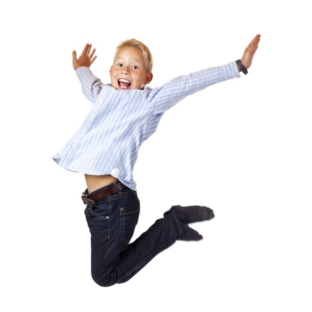 hurray: Happy sportive boy jumps with spread arms in the air. Isolated on white background. Stock Photo