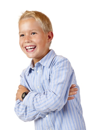 enquiring: Portrait of young smiling boy with crossed arms. Isolated on white background.