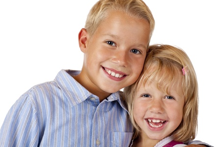 scallywag: Boy and girl are smiling happy into camera. Isolated on white background. Stock Photo