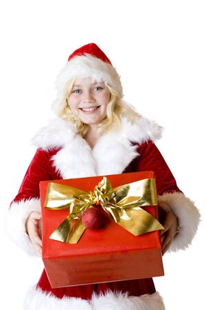 Young girl with christmas present smiles happy. Isolated on white background. Stock Photo - 9078048