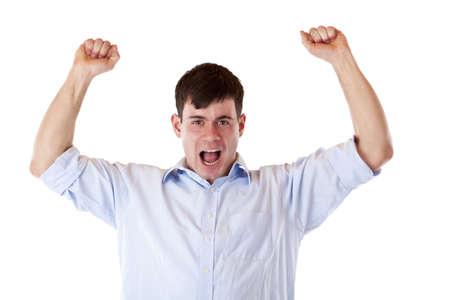 Jonge aantrekkelijke succesvolle man jubilates met chlenched vuisten. Geïsoleerd op een witte achtergrond.