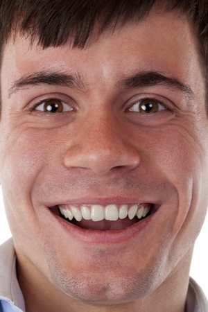 Face of a young, happily smiling man. Isolated on white background. photo
