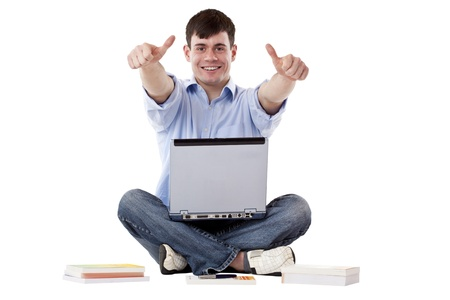 Young, handsome man with computer express success with thumbs up. Isolated on white background. Stock Photo