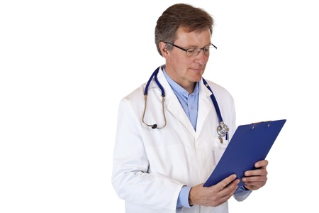 Attractive, older, concentrated male doctor reads checklist from clipboard. isolated on white background. photo