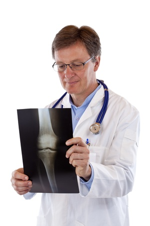 Older, competent male senior doctor watching x-ray image of bone. Isolated on white background.
