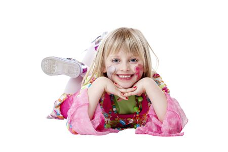Young blond disguised pretty girls lies on the floor and smiles.Isolated on white background photo