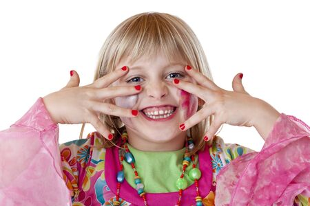 Young blond disguised girl shows red fingernails and laughs. Isolated on white background.. photo